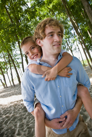 Father giving son piggy back ride stock photo, Father giving son piggy back ride by Jonathan Ross