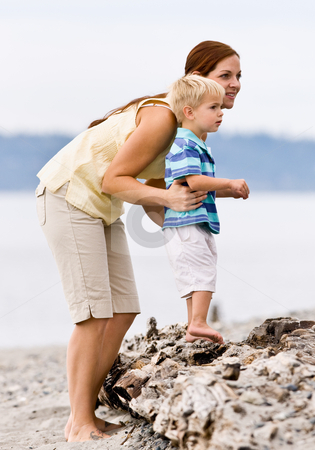 Mother and son at beach stock photo, Mother and son at beach by Jonathan Ross