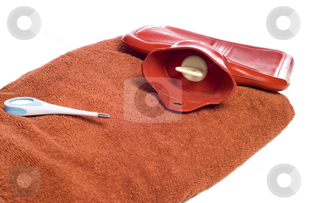 Sickness Objects stock photo, Three objects people commonly use when they are sick, including a hot water bottle, a thermometer, and a towel, isolated against a white background by Richard Nelson