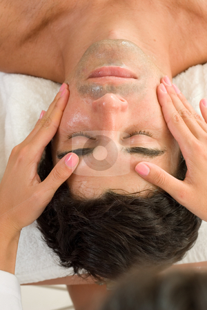 Facial Massage stock photo, A male receives a facial massage by Leah-Anne Thompson
