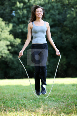 Young, sporty woman with skipping stock photo, Young, sporty woman with skipping, laughing, looking at the camera by Christine Langer-Pueschel