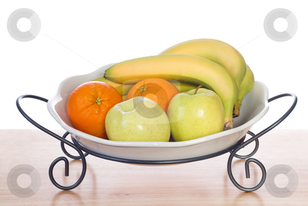 Bowl of Fresh Fruit stock photo, Assorted fresh fruit including bananas, oranges and apples, sitting in a bowl and shot on a wooden table by Richard Nelson