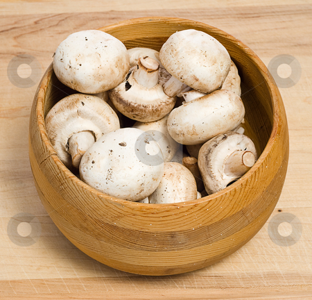 White Mushrooms stock photo, A bowl of white mushrooms, shot on a wooden cutting board by Richard Nelson