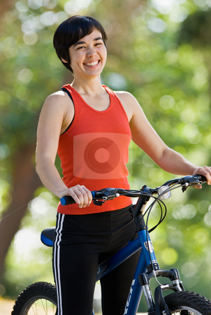 Woman on bike smiling stock photo, Woman on bike smiling by Jonathan Ross