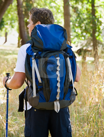 Man hiking with backpack stock photo, Man hiking with backpack by Jonathan Ross