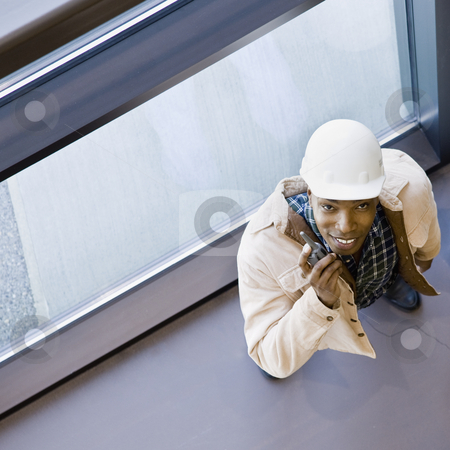 Male Construction Worker stock photo, Male construction worker with two way radio.  Square framed shot. by Jonathan Ross