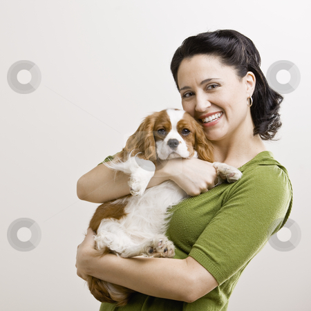Adult Woman with Puppy stock photo, Adult female holding puppy. Square format. by Jonathan Ross
