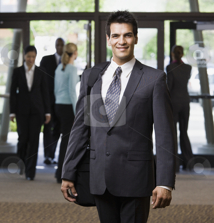 Young Businessman Smiling stock photo, Young businessman smiling.  Square framed shot. by Jonathan Ross