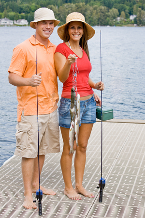 Couple fishing on pier stock photo, Couple fishing on pier by Jonathan Ross