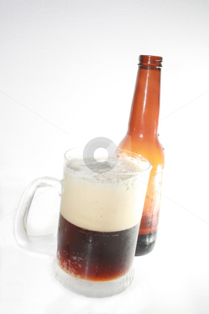 Root Beer stock photo, A frosty mug of root beer, and a bottle, isolated against white by Rob Wright