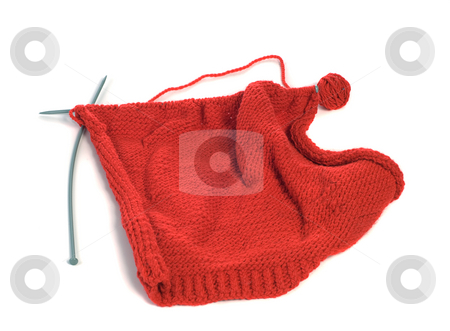 Knitting stock photo, A sweate in the progress of being knitted, shot against a white background by Richard Nelson