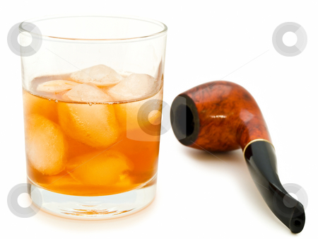 Glass of alcoholoic drink stock photo, Glass of alcoholoic drink with ice cubes and tobacco pipe by Sergej Razvodovskij