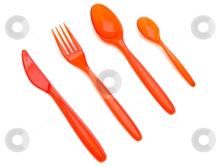 Plastic fork knife and spoons stock photo, Photo of the red plastic fork knife and spoons against the white background by Sergej Razvodovskij