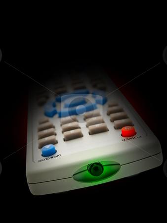 Remote control stock photo, Remote control over the black background by Sergej Razvodovskij