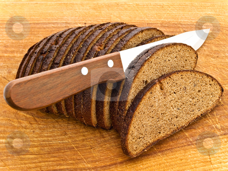 Bread and knife stock photo, Photo of background the slice bread and  knife at wooden broad by Sergej Razvodovskij