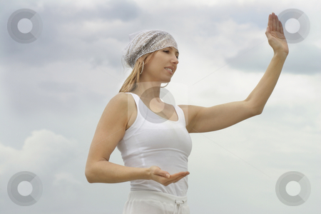Tai Chi stock photo, Tai chi is a form of moving meditation by doing sequences of movements with slow soft and graceful transitions between them. by Leah-Anne Thompson