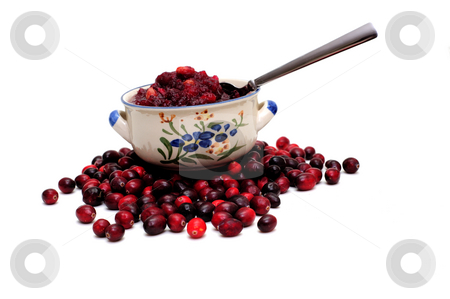 Cranberry Sauce And Berries stock photo, A side view of a bowl of fresh cranberry sauce with raw cranberries under the bowl by Lynn Bendickson
