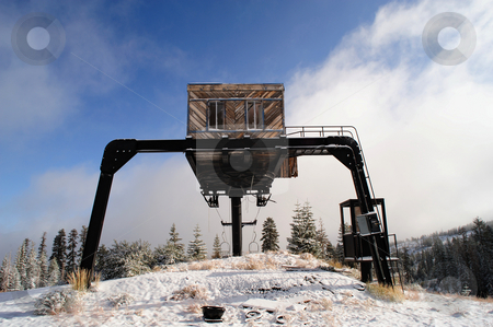 Abandoned Ski Lift stock photo, An old abandoned ski lift at the top of a mountain in the California Sierra Nevada mountains with a light covering of new snow by Lynn Bendickson