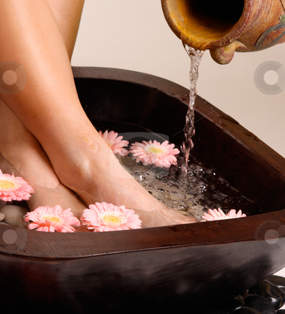 Relaxing pedispa stock photo, Feet enjoy a relaxing aromatherapy foot spa by Leah-Anne Thompson
