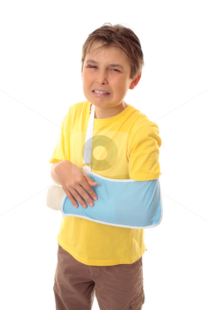Unhappy boy broken arm stock photo, Injured young boy with sore arm in an arm sling by Leah-Anne Thompson