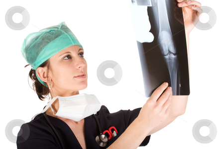 Young Caucasian female doctor examining an x-ray stock photo, Young attractive Caucausian female health care worker examining an x-ray of a human knee. Isolated on white background by Andre van der Veen