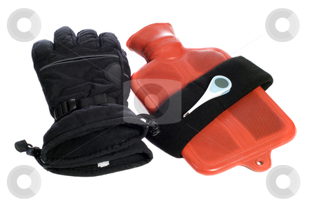 Keep Warm stock photo, Some common objects that keep a body warm are gloves, a headband, and a hot water bottle, along with a thermometer to check the temp, isolated on white by Richard Nelson