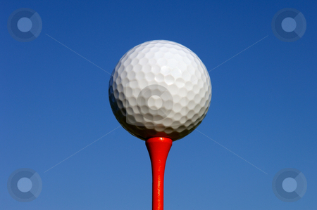 White Golf Ball on Red Tee stock photo, Image of a white golf ball sitting on a red tee by Greg Blomberg