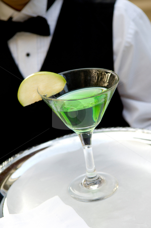 Bright green apple martini stock photo, An image of a bright green apple martini by Greg Blomberg