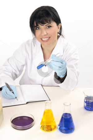 Scientific research worker stock photo, A scientist or other laboratory worker jotting down notes and observations of tests. by Leah-Anne Thompson