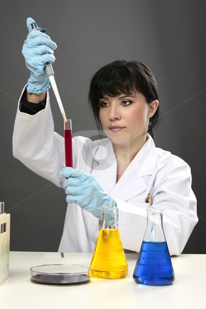 Scientific research test tube science stock photo, A scientific researcher conducting research, developing a cure or testing for disease or other substances in a laboratory. by Leah-Anne Thompson