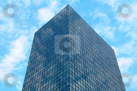 Office building over sky stock photo, A perspective view of commercial building over sky by Tito Wong