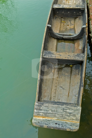 Rowboats stock photo, The anchored boats on a river of city park by Tito Wong