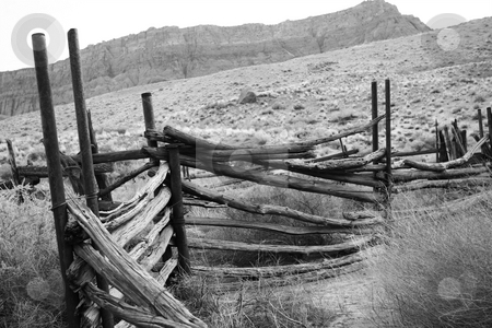 Black and white abandoned corral stock photo, Old corral in the desert by Greg Peterson