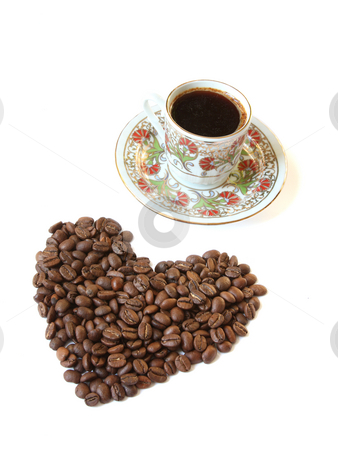 Cup of coffee and heart shaped coffee beans stock photo, A cup of coffee and heart shaped coffee beans. Isolated on white by Olga Lipatova