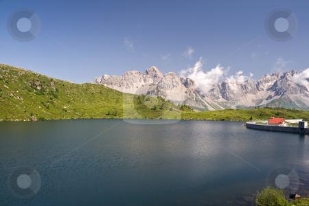 Cavia lake stock photo, Summer view of lake Cavia near San Pellegrino pass, Trentino, Italy by ANTONIO SCARPI
