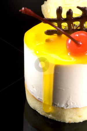 Piece of fruit cake  stock photo, Piece of fresh fruit cake close up over black reflective surface by Francesco Perre
