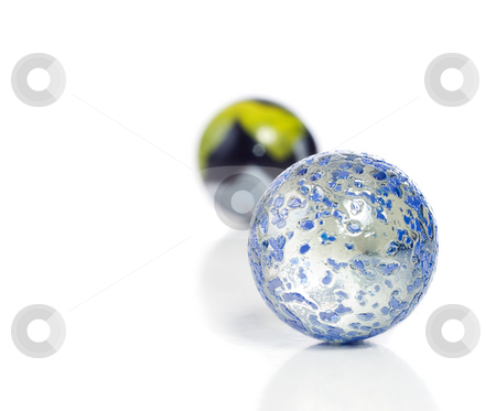 Marbles stock photo, Closeup view of a game of marbles shot on a white background with a slight reflection on the surface by Richard Nelson