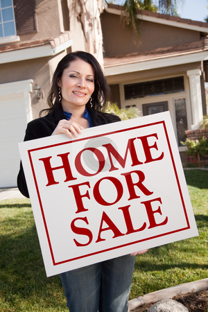 Woman Holding Home For Sale Real Estate Sign In Front of House stock photo, Hispanic Woman Holding Home For Sale Real Estate Sign In Front of House. by Andy Dean