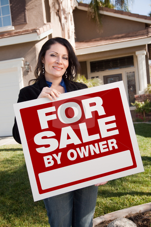 Hispanic Woman Holding For Sale By Owner Real Estate Sign In Fro stock photo, Happy Attractive Hispanic Woman Holding For Sale By Owner Real Estate Sign In Front of House. by Andy Dean