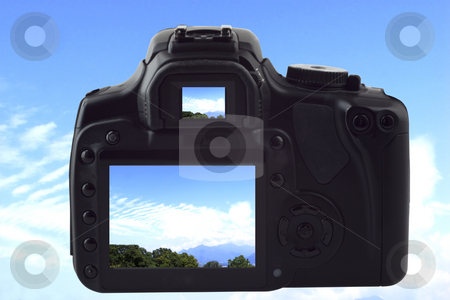 Photocamera shooting sky stock photo, A black reflex photocamera shooting landscape of blue sky with clouds, same image on live view and viewfinder by Fabio Alcini