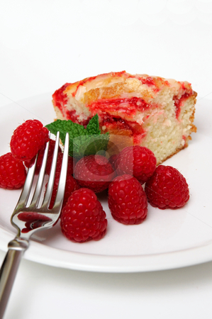 Raspberries And Coffee Cake stock photo, Raspberry coffee cake and fresh raspberries with a sprig of fresh mint leaves on a white saucer and silver metal fork by Lynn Bendickson