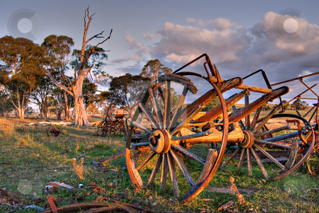 Old cart stock photo, An old cart lays rotting on the farm at sunset by Phil Morley