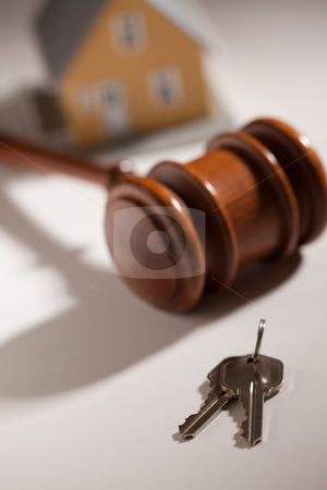 Gavel, House Keys and Model Home stock photo, Gavel, House Keys and Model Home on Gradated Background with Selective Focus. by Andy Dean