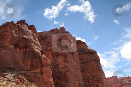 Blue sky over desert cliffs stock photo, Blue skies on a sunny day in southern Utah's desert by Greg Peterson