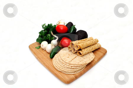 Tortillas, Taquitoes and Veggies stock photo, Taquitos with other natural ingredients including homemade tortillas, avocados, tomatoes, small sweet onions and jalapeno chilies by Lynn Bendickson