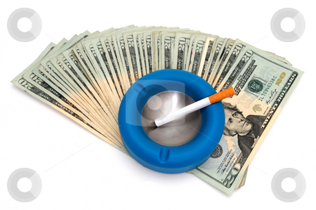 Expensive Habit stock photo, An un-lit cigarette with a blue and silver ashtray on top of many twenty dollar bills showing concept of the high cost of addiction to cigarettes by Lynn Bendickson