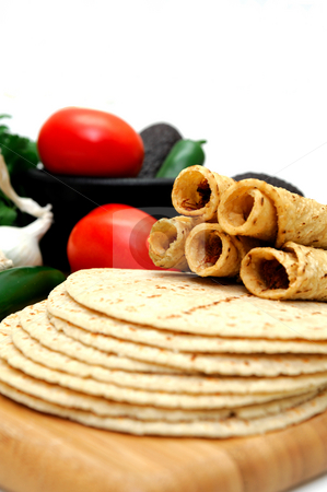 Tortillas stock photo, Taquitos with other natural ingredients including homemade tortillas, avocados, tomatoes, small sweet onions and jalapeno chilies by Lynn Bendickson