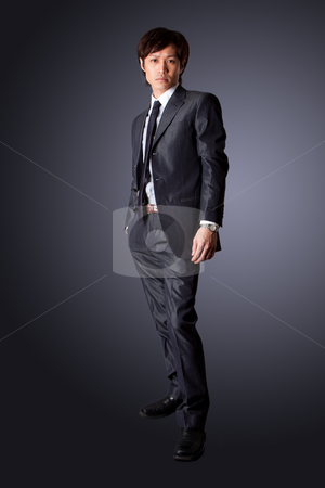 Successful Asian business man stock photo, Successful Asian business man standing with confidence, isolated. by Paul Hakimata