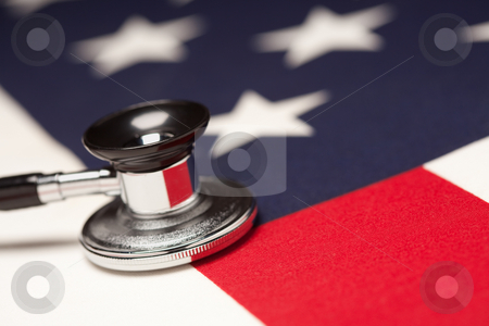Stethoscope on American Flag stock photo, Stethoscope on American Flag with Selective Focus. by Andy Dean