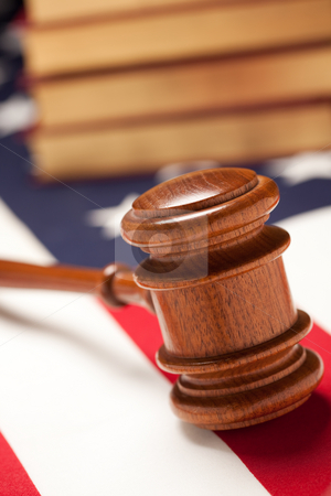 Gavel and Books on Flag stock photo, Gavel and Books on the American Flag with Selective Focus. by Andy Dean